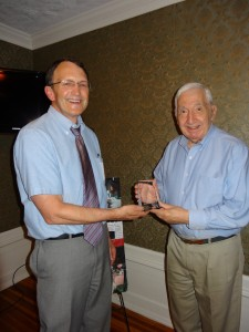 Lance Chaffee, director, presents John Mansour with a Plaque for his 27 Years of Dedicated Service